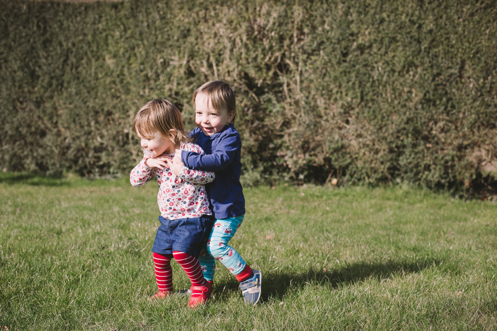 Toddler twins playing in the garden