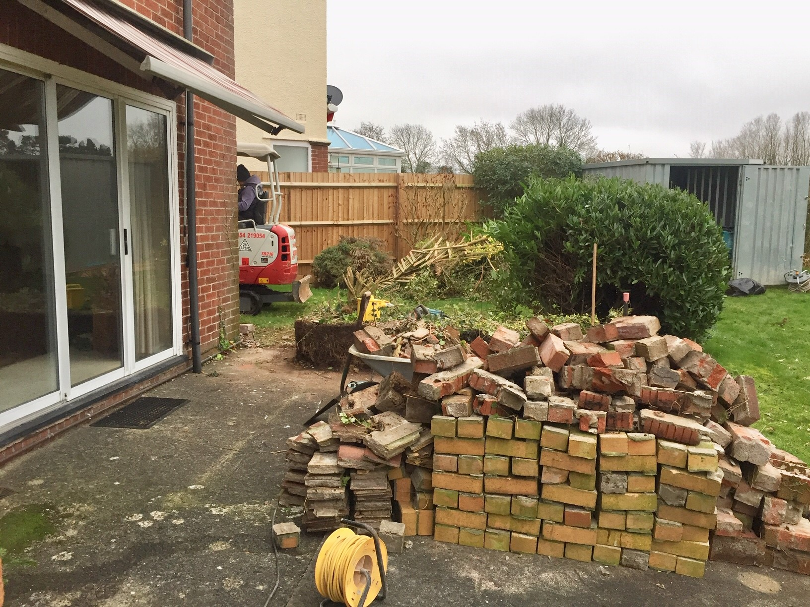 Digging up the old patio ready to lay the new extension footings