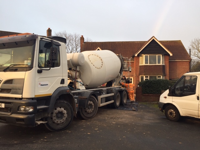 The cement mixer arrives to deliver our concrete