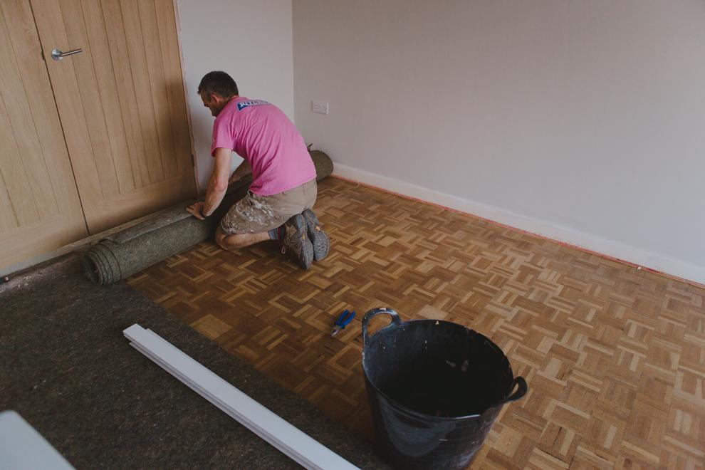 The beautiful oak parquet flooring hidden under the old 1960s carpet
