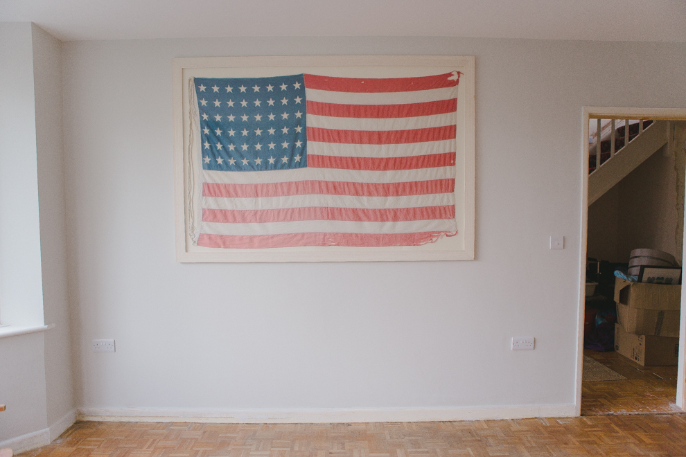 Hanging the American flag wall decor in the playroom